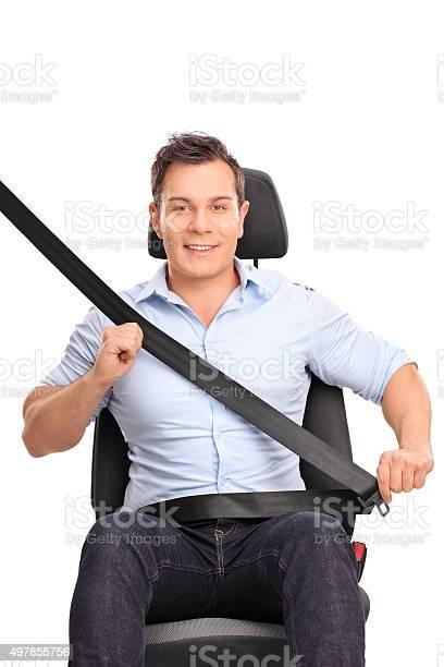 Man fastening his seat belt on a car seat picture id497855756?b=1&k=6&m=497855756&s=612x612&h=spogdsnyog25gy73exmwwzglg1ki f6dyoeml n dyw=