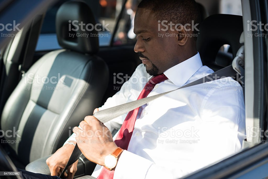 Man fastening the safety belt stock photo