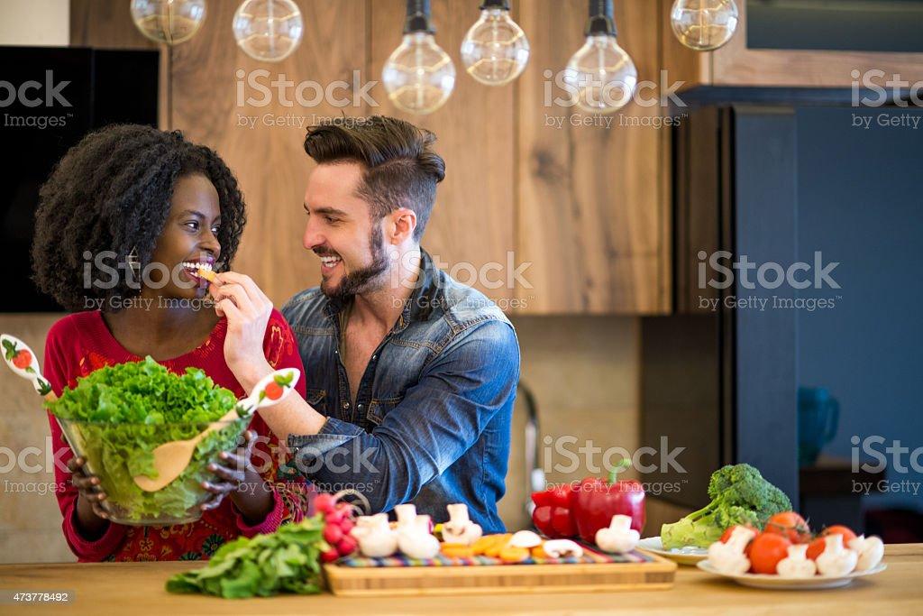 Man feeding woman with carrot stock photo