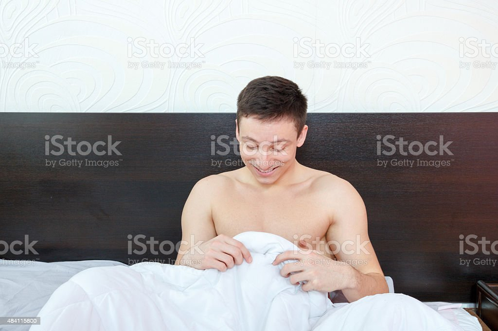 Man feeling a bit shame of his strong erection stock photo