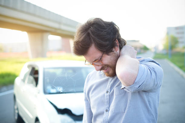 Man feeling pain to the neck after car crash stock photo