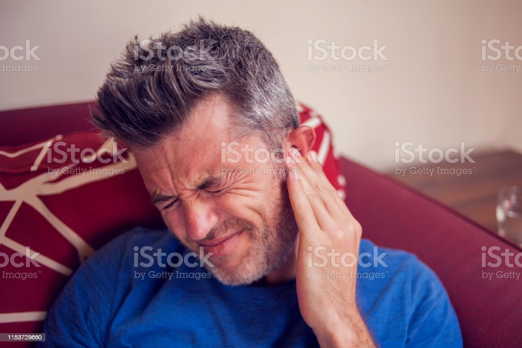 Man feels strong ear pain at home. People, healthcare and medicine...