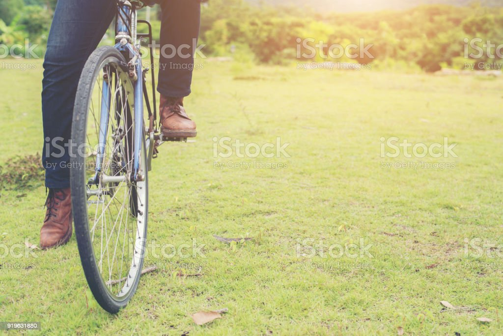 Man feet pedal bike in the nature park, Ready to ride. stock photo