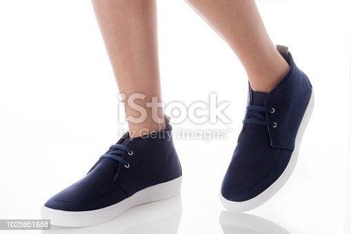 917262406istockphoto Man feet wearing blue fashion shoes in hipster style, step with side view, Isolated on white background, Men's Fashion concept. 1025851658