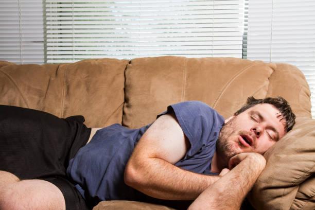 man fell asleep for a nap stock photo
