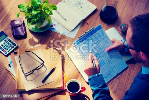 istock Man Filing Out Application In Morning Sun 482232067