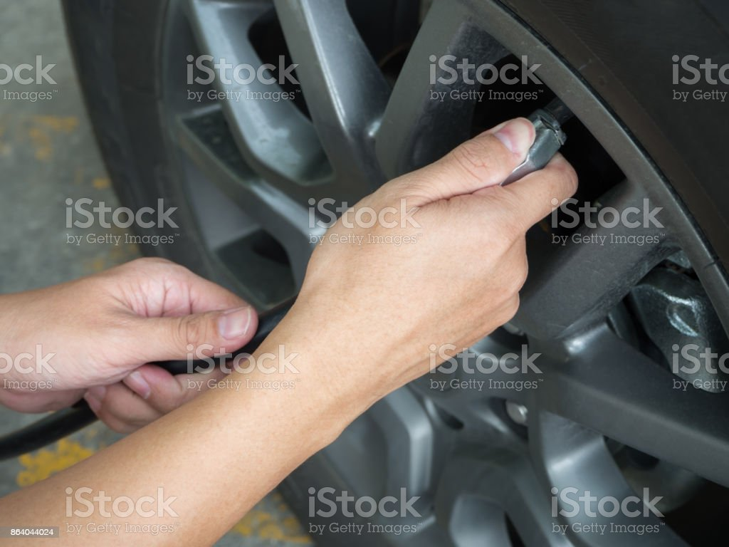 Man fill the air for tires stock photo