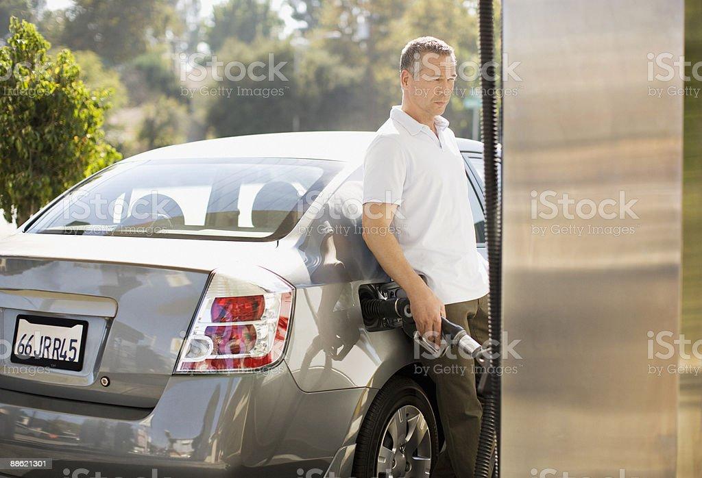 Man filling car at gas station stock photo