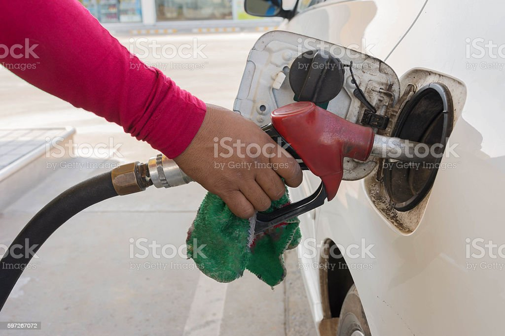 Man Filling Car With gasoline royalty-free stock photo
