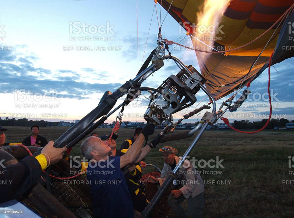 man filling hot air into balloon royalty-free stock photo