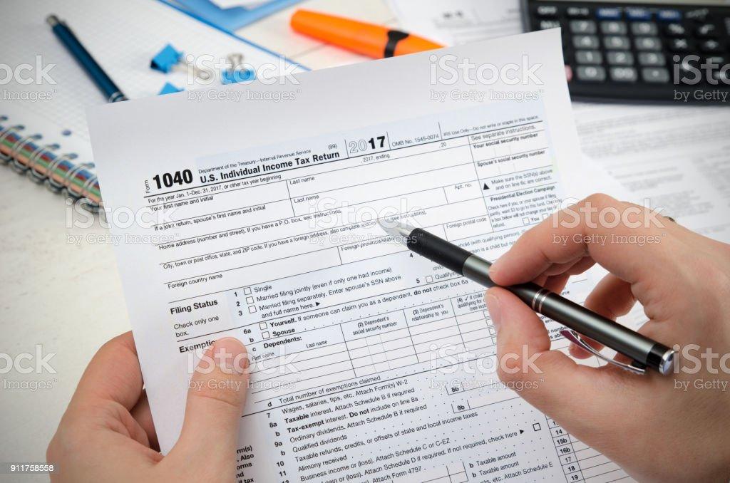 Man filling US tax form. stock photo