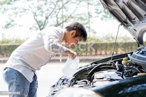 istock Man filling water into boiling tank. 1173875593