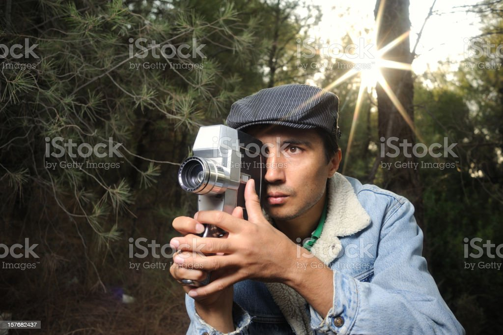 Man filming with 16mm movie camera royalty-free stock photo