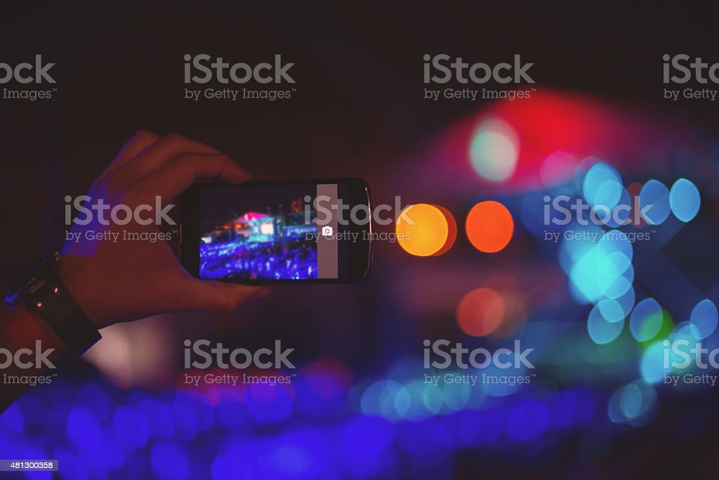 Man filming with smartphone stock photo