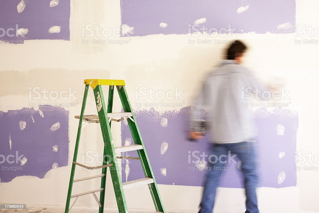 Man finished a sheetrock wall on home addition stock photo