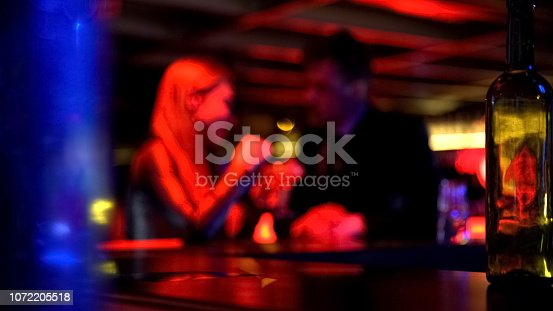 istock Man first meeting with lady in nightclub, talking privately, romantic atmosphere 1072205518