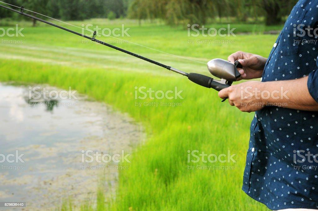 Man Fishing Close-Up stock photo