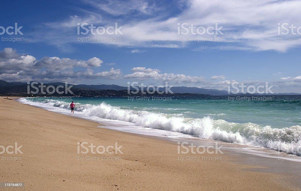 Man fishing -Corsican beaches serie stock photo