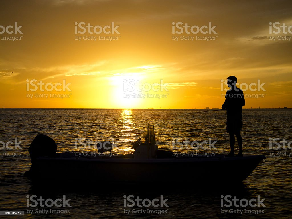 Man fishing from bow in Gulf of Mexcio stock photo