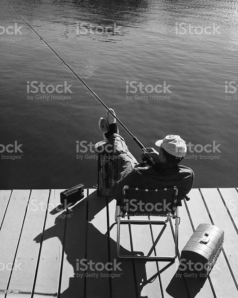 Man fishing from dock royalty-free stock photo
