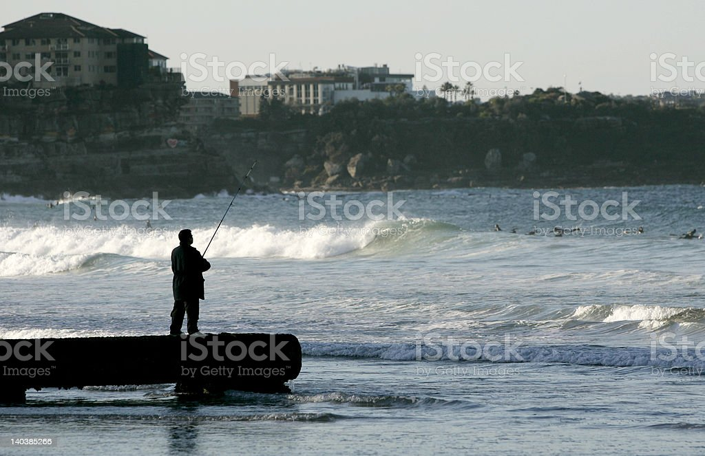 Man Fishing in Manly royalty-free stock photo