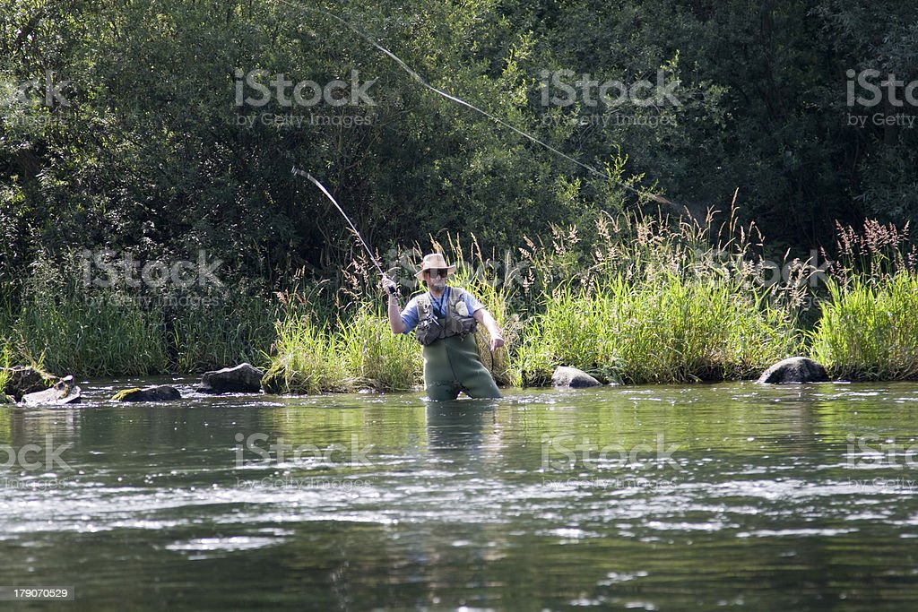 Man fishing in the river stock photo