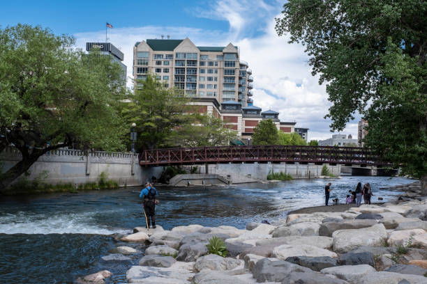 Man Fishing in the Truckee River in Downtown Reno stock photo