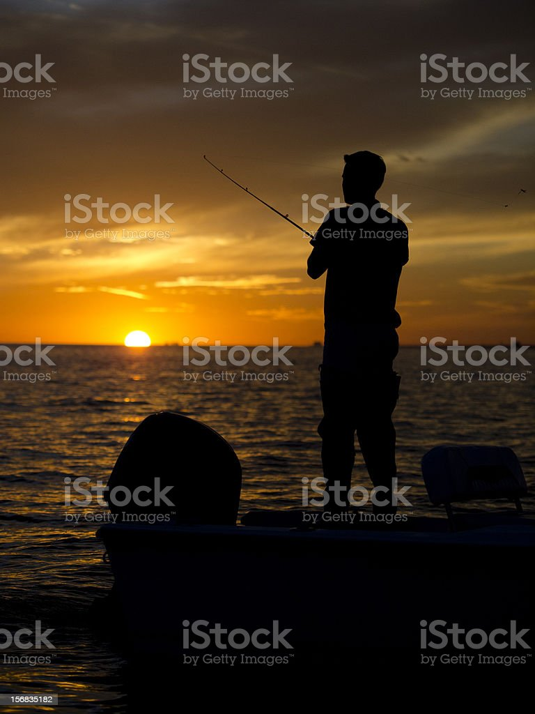Man fishing off boat in Gulf of Mexico stock photo