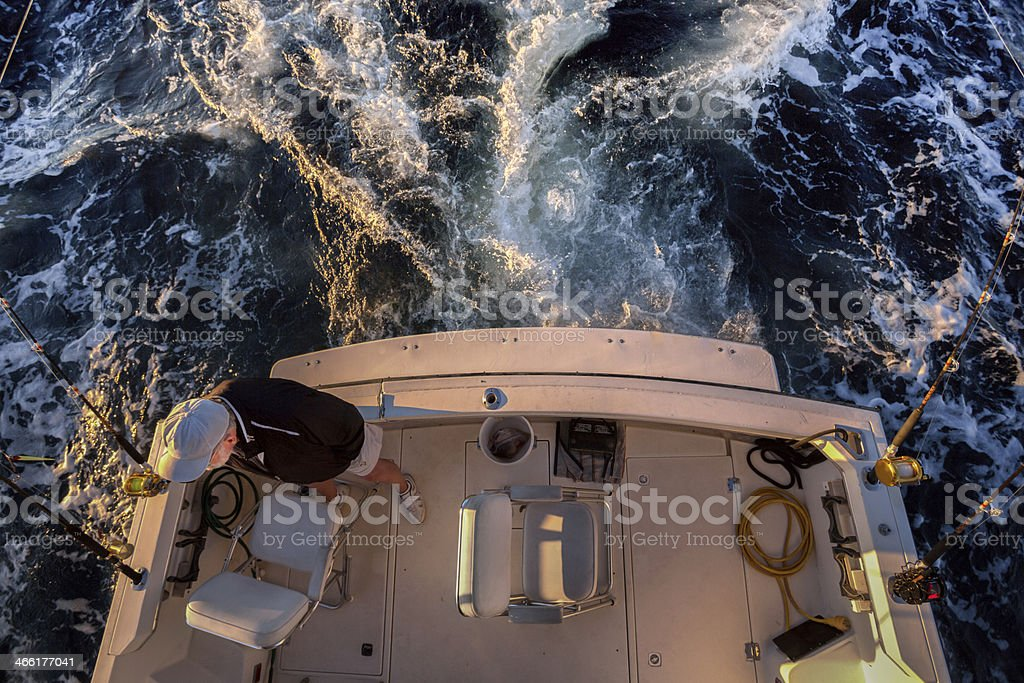 Man Fishing on a Boat stock photo