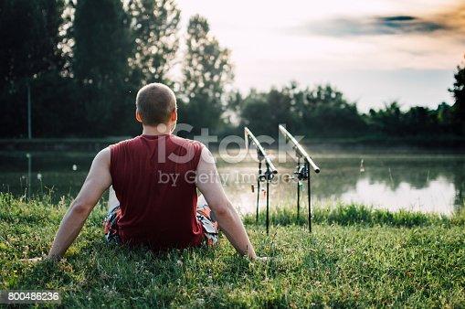 992209122 istock photo Man fishing on a lake 800486236