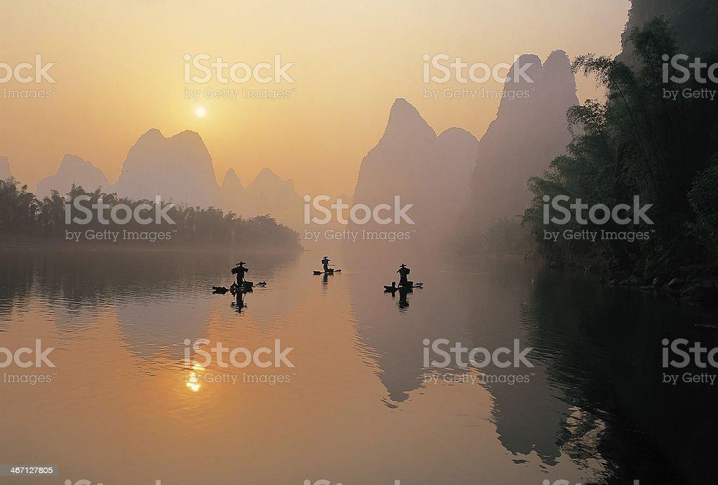 Man fishing on the Li River stock photo