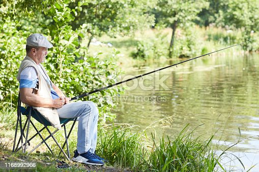 483319252 istock photo Man fishing outdoors 1168992966