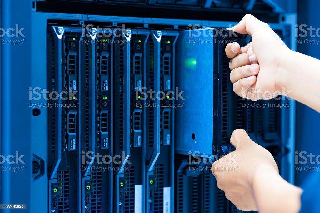 Man fix server network in data center room stock photo