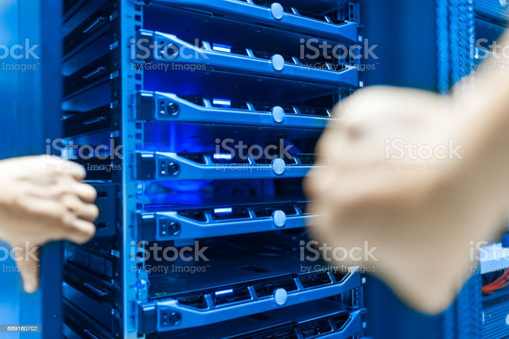 Man fix server network in data center room stock photo