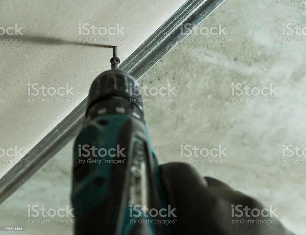 Man fixes the drywall stock photo