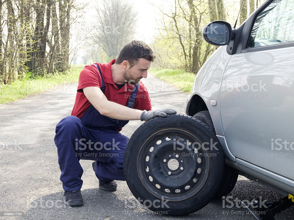 man fixing a car problem stock photo