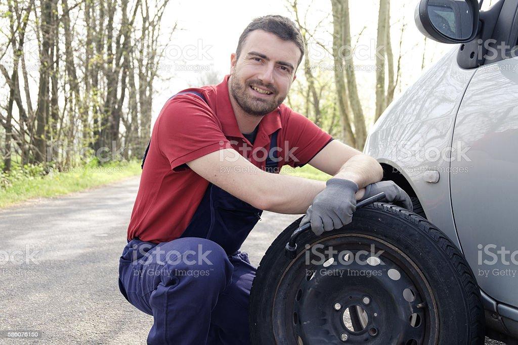 man fixing a car problem stock photo