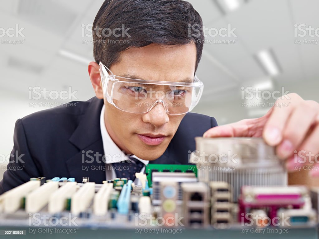 man fixing computer stock photo