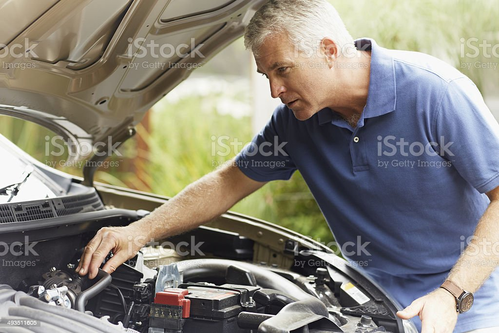 Man fixing his car engine stock photo