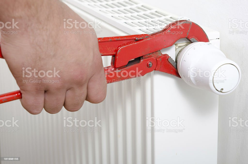 Man fixing radiator royalty-free stock photo