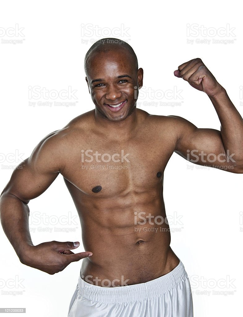 Man flexing and pointing to his waist royalty-free stock photo