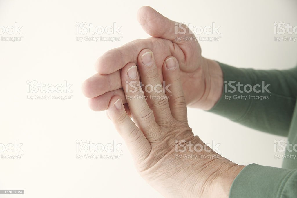 man flexing fingers against hand royalty-free stock photo