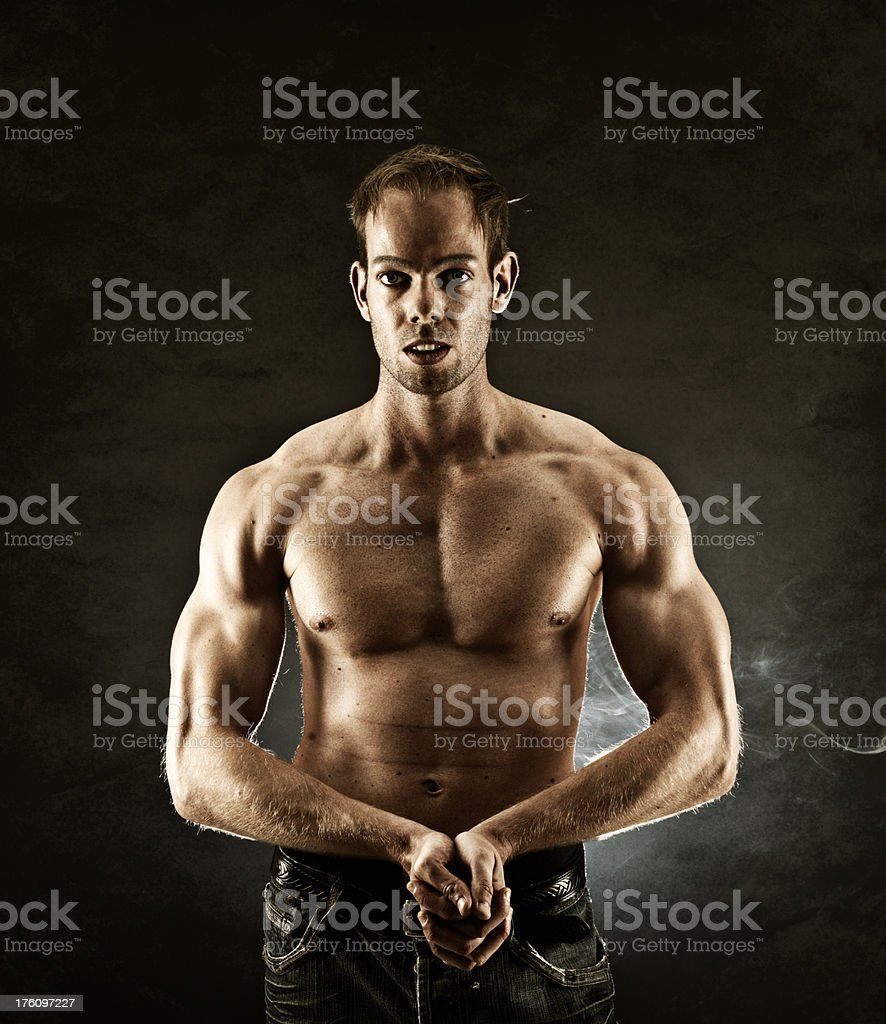 Man flexing his muscles royalty-free stock photo