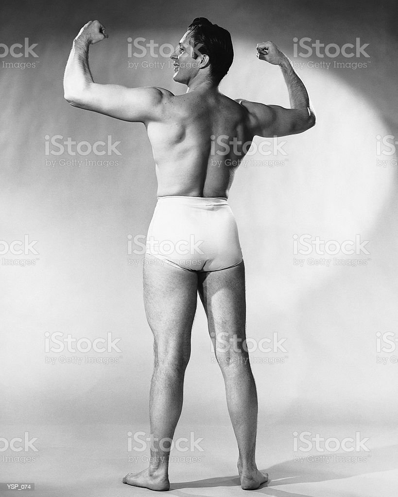 Man flexing muscles royalty-free stock photo