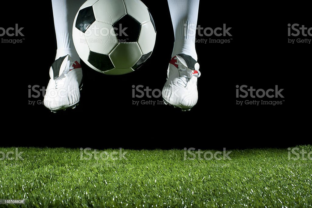 man flicking a soccer ball with his feet royalty-free stock photo