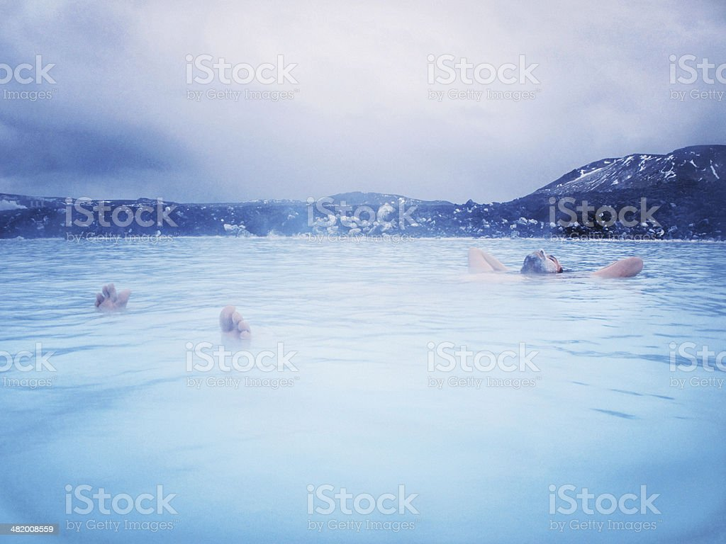 Man Floating in the Blue Lagoon, Iceland stock photo