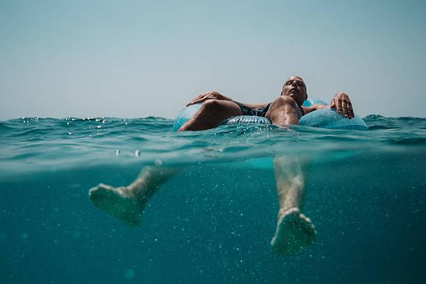 Man floating in the Mediterranean Sea in Croatia stock photo