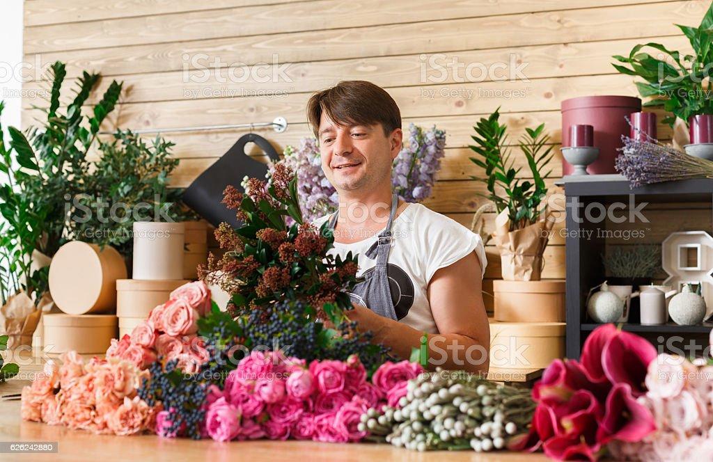 Man Florist Assistant In Flower Shop Delivery Make Rose Bouquet ...
