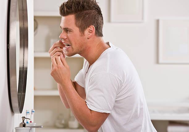 Man Flossing Teeth stock photo