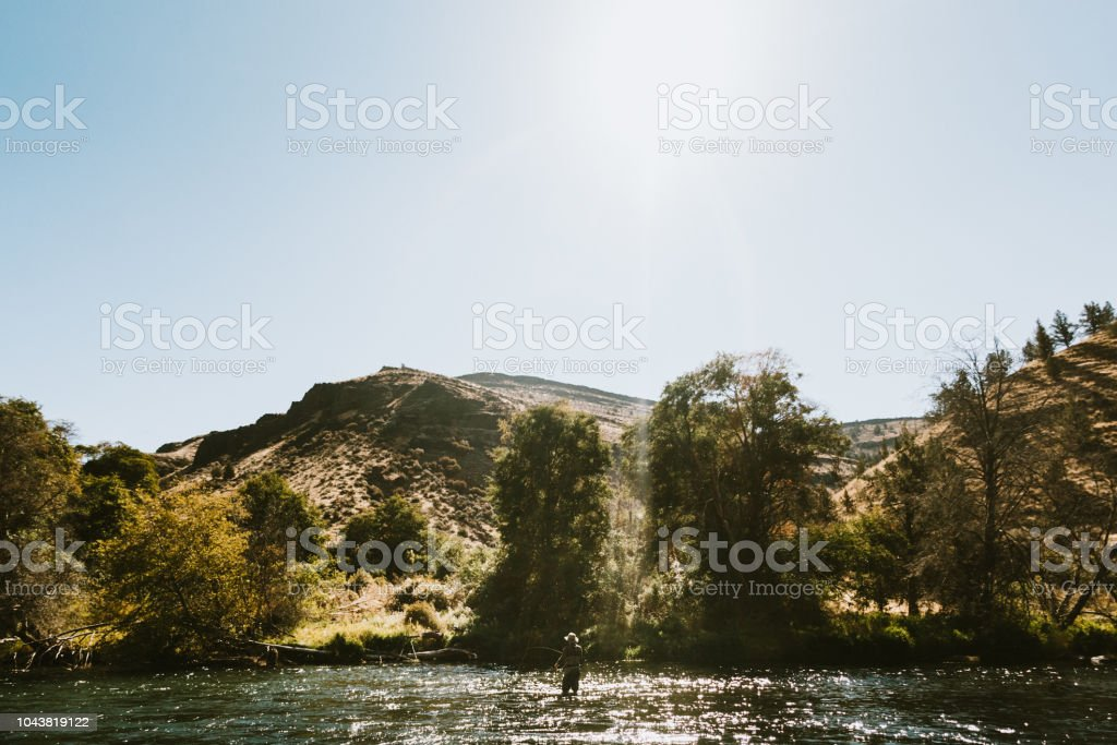 Man Fly Fishing On Deschutes River Rafting Trip Stock Photo